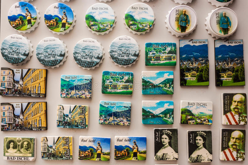 Souvenir magnets displayed for sale in a souvenir shop, Bad Ischl, Austria. Bad Ischl, Austria - September 2, 2016: Souvenir magnets with views of Bad Ischl and stock images