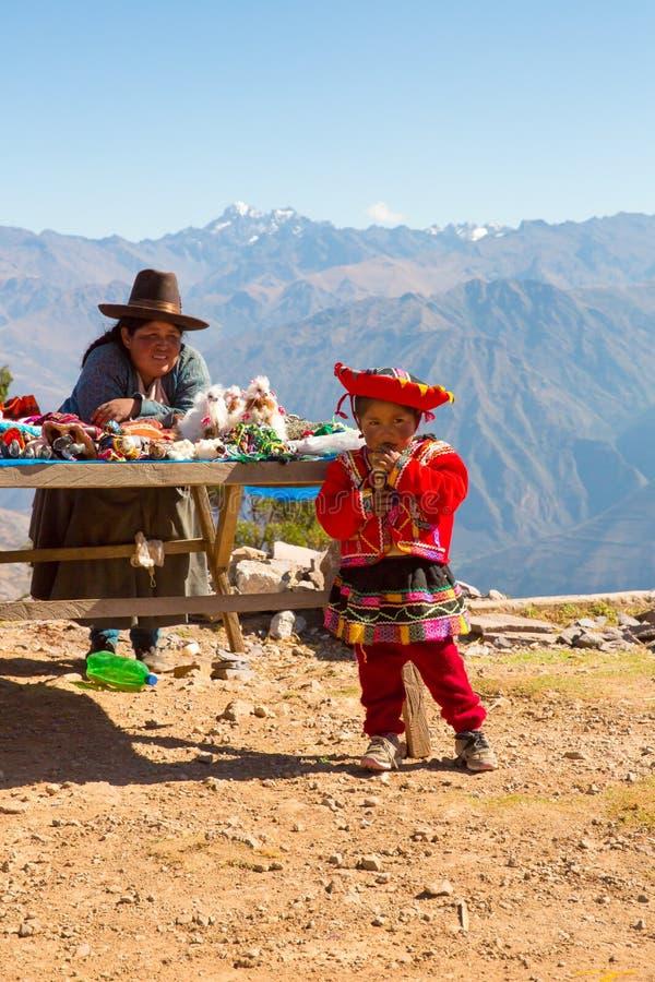 Souvenir market on street of Ollantaytambo,Peru,South America. Colorful blanket, cap, scarf, cloth, ponchos. From wool of alpaca, llama stock photography