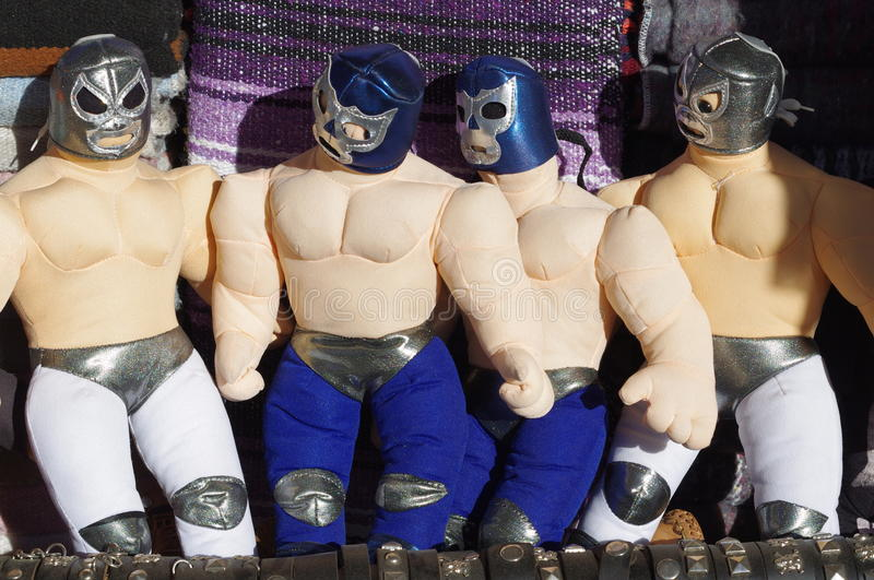 Souvenir of Mexican wrestlers. Souvenir shops displaying Mexican wrestlers with its colourful masks royalty free stock photos
