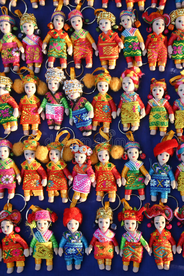 Souvenir miniature dolls from Laos. Miniature dolls on a keychain from Laos stock photo