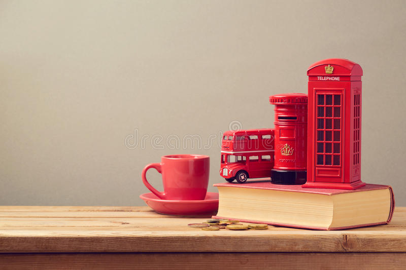 Souvenir money box from trip to London, Great Britain on book royalty free stock image