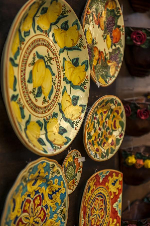 A Souvenir Plate with an Italian design for sale in Tropea, Italy. stock images