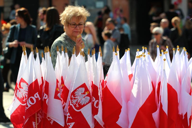 Souvenir Polish flags at a street market in Old Town of Warsaw on the 1st of May, The International Workers Day. Warsaw, Poland - May 1, 2019: Souvenir Polish royalty free stock photo