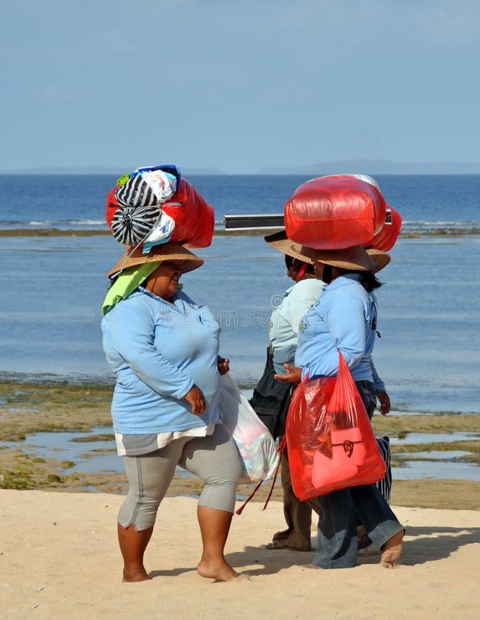 Souvenir Sellers Head Home, Bali Indonesia stock photos