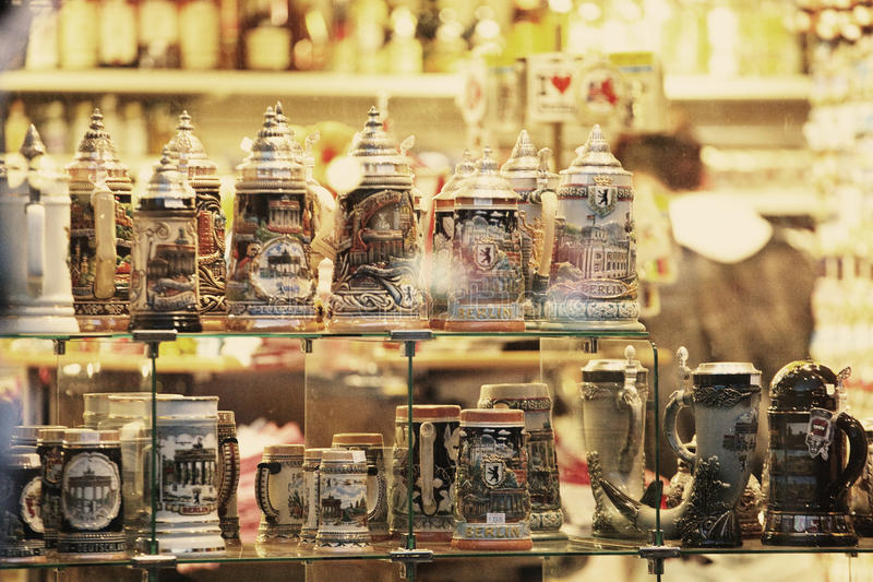 Souvenir shop in Berlin. Traditional beer drafts in a souvenir shop from Berlin, night shot royalty free stock photos