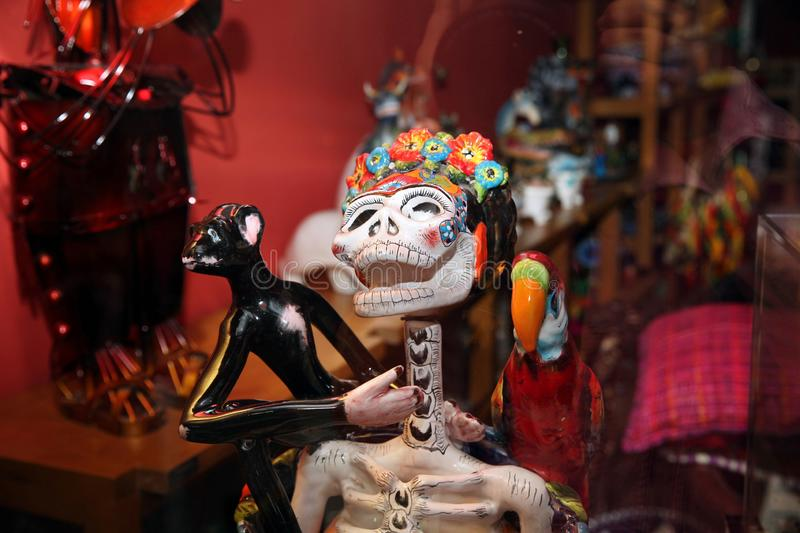 Souvenir shop window, Mexican sculpture funny female skull close-up royalty free stock photography