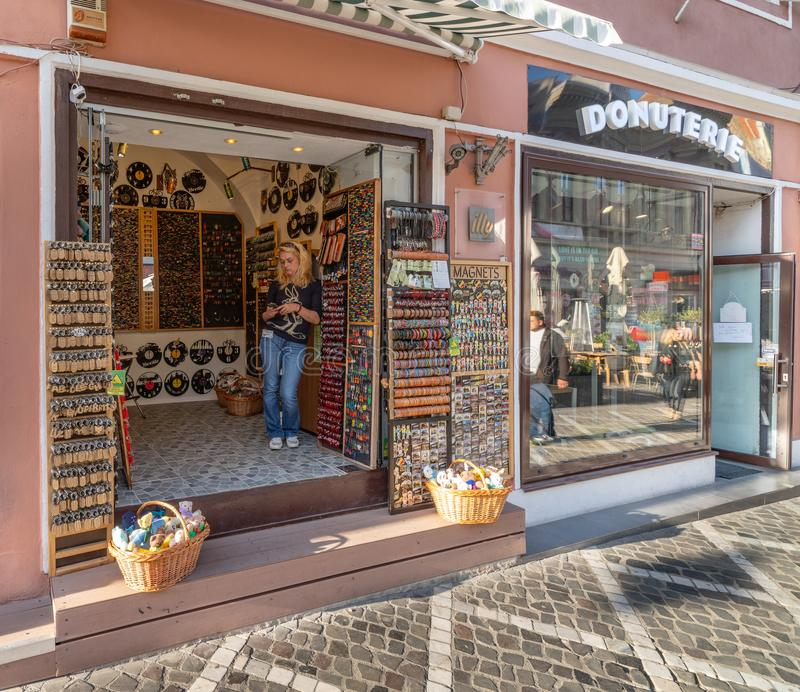 Souvenir shops on the pedestrian street of old Brasov, Romania. One of the ten largest cities in Romania. Located in the heart of Romania, the city of Brasov is stock photo