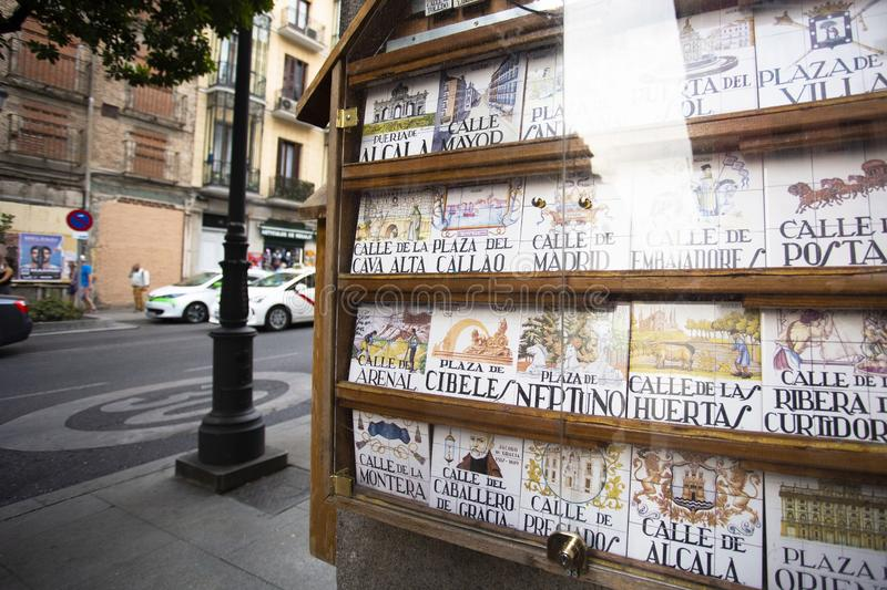 Souvenir showcase with traditional tile street signs in Madrid, Spain sight of the city 2018-08-07. Souvenir showcase with old traditional tile street signs in stock images