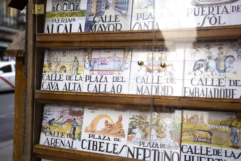 Souvenir showcase with traditional tile street signs in Madrid, Spain sight of the city 2018-08-07. Souvenir showcase with old traditional tile street signs in royalty free stock photo
