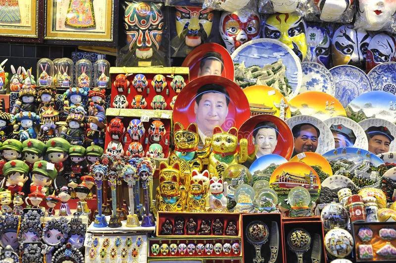 A souvenir stall at a Beijing night market selling Xi Jinping face plates and other kitsch rubbish. BEIJING, CHINA - OCT 19, 2014 - A souvenir stall at a stock photo