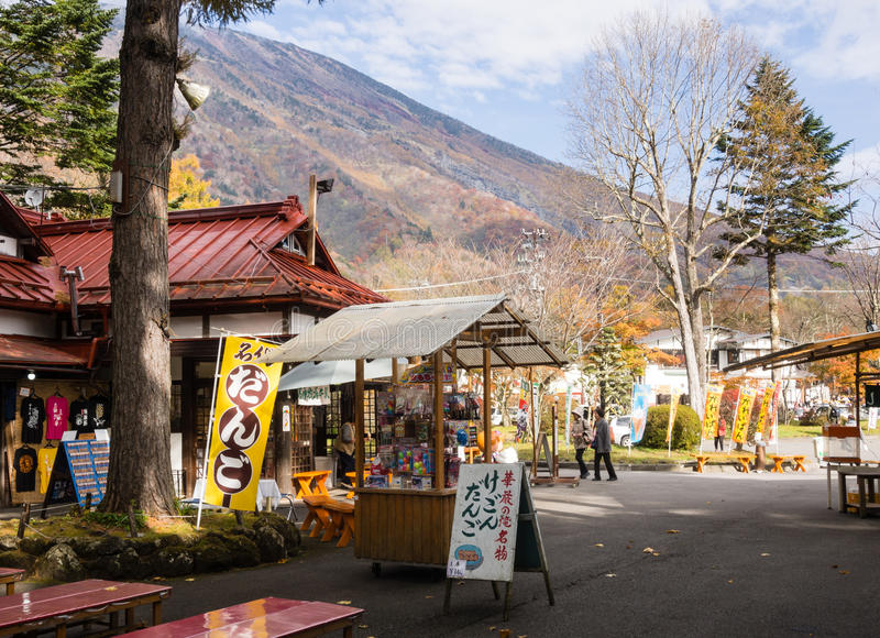 Souvenir stalls at the entrance to Kegon falls in Nikko national park, Japan. Nikko, Japan - October 25, 2016: Souvenir stalls and food vendors at the entrance stock photos