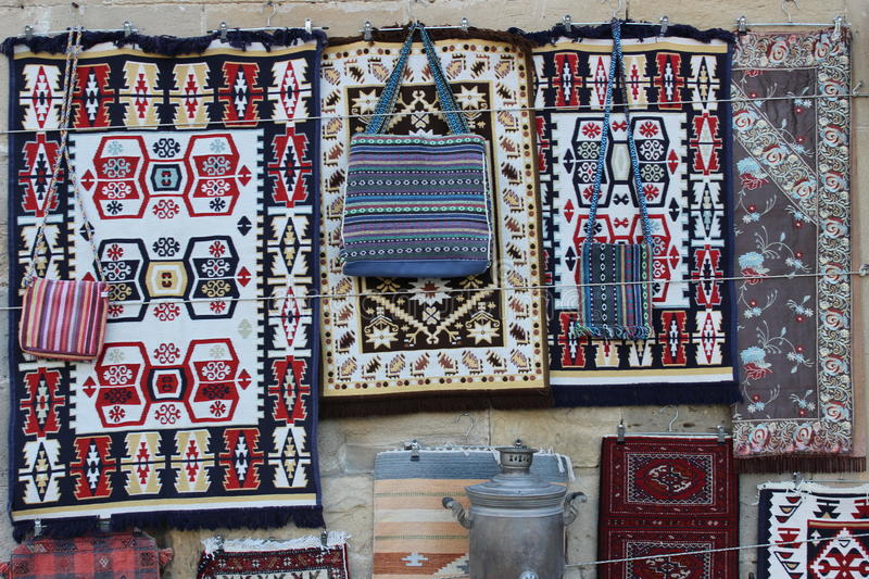 Souvenir stand in Baku old town. A souvenir stand in the old town area of Baku, Azerbaijan. Here are pots, plates, persian rugs, lamps, traditional dresses and royalty free stock images