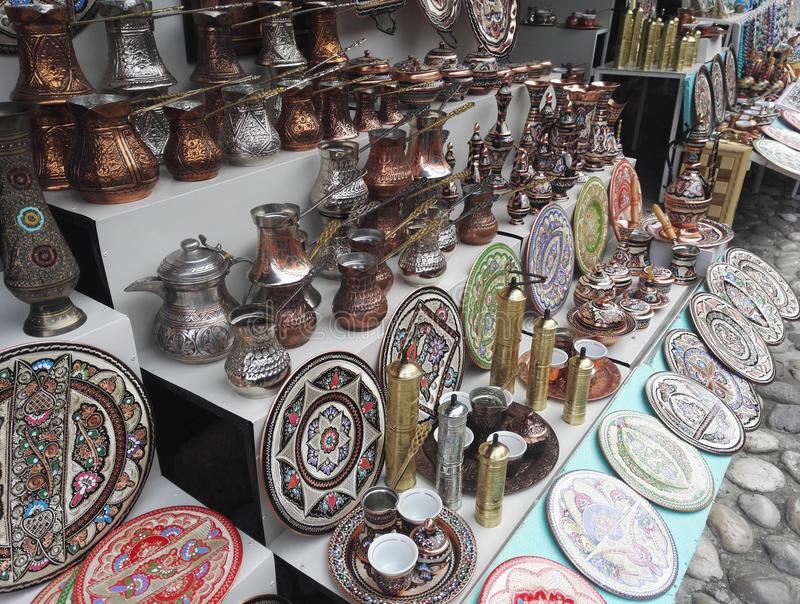 Souvenir stand, traditional handcrafted cooper coffee pots stock photos