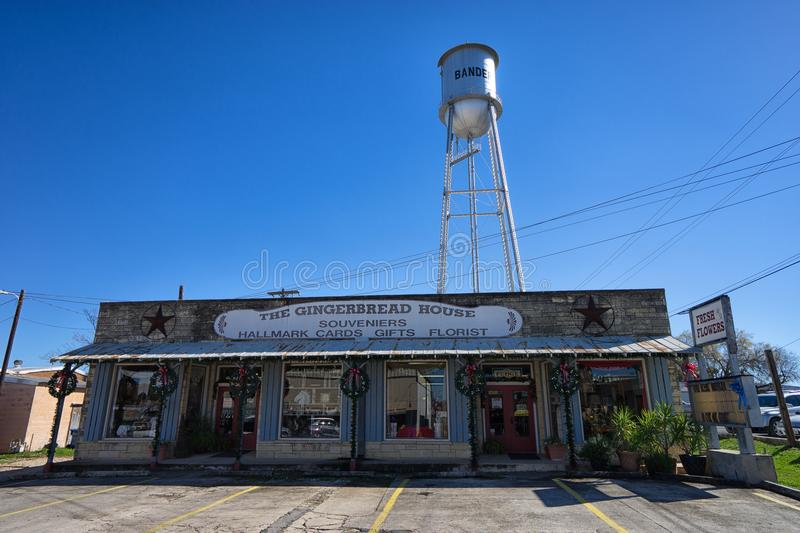 Souvenir store front Bandera Texas. January 7, 2016 Bandera, Texas, USA: souvenir store front with water tower above in the small historic cowboy town stock photo
