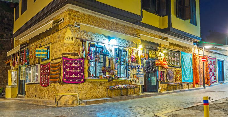 Souvenir store in historical townhouse, Antalya, Turkey. The large souvenir store with carpets, embroidered cloths, accessories, jewelries and different stock photography