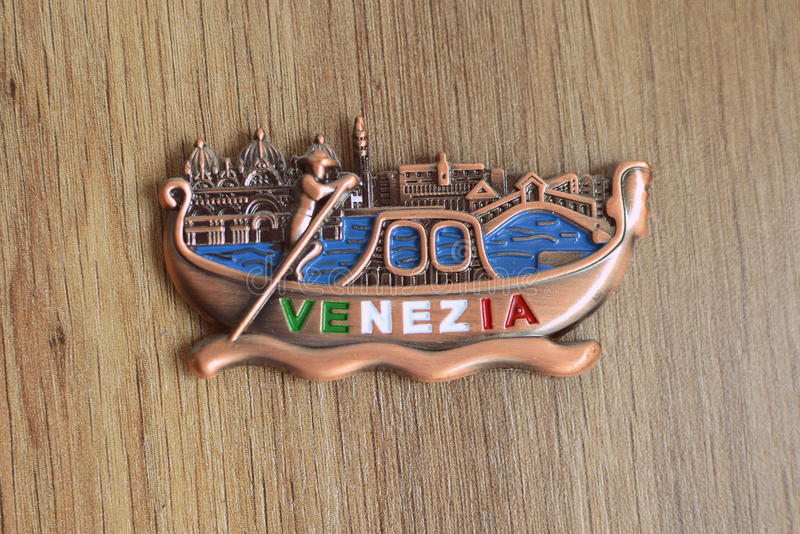 Souvenir from Venice, Italy. On the map of Italy stock photo