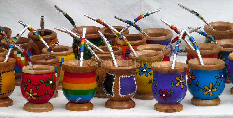 Souvenir yerba matte cup. In El Bolson, Argentina. Colored cups for mate. Bambillya calabash sold as souvenir at the market royalty free stock images