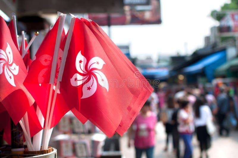 SouvenirHong Kong nationsflaggor på Stanley Market, Hong Kong royaltyfri bild