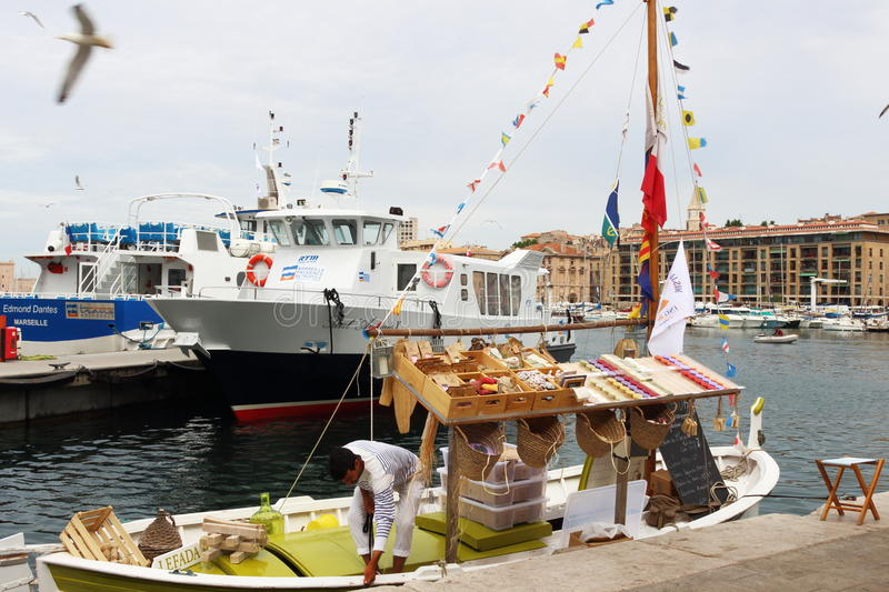 Souvenirs boat in Marseille harbour, France stock images