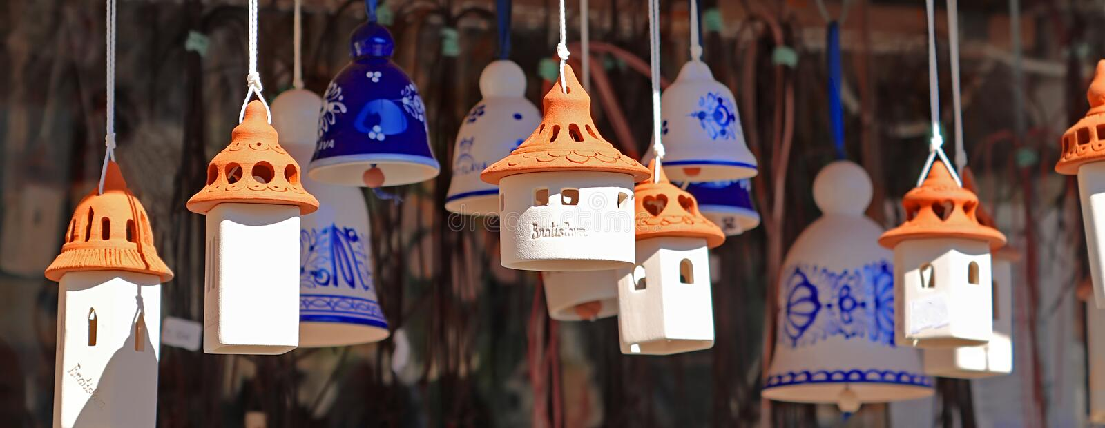 Souvenirs from Bratislava, Slovakia. Clay bells made in the form of houses stock photo