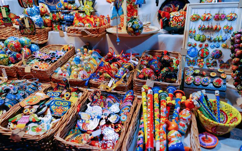 Souvenirs on Night Christmas Market at Town Hall in Winter Berlin, Germany. Advent Fair Decoration and Stalls with Crafts Items on. The Bazaar royalty free stock images