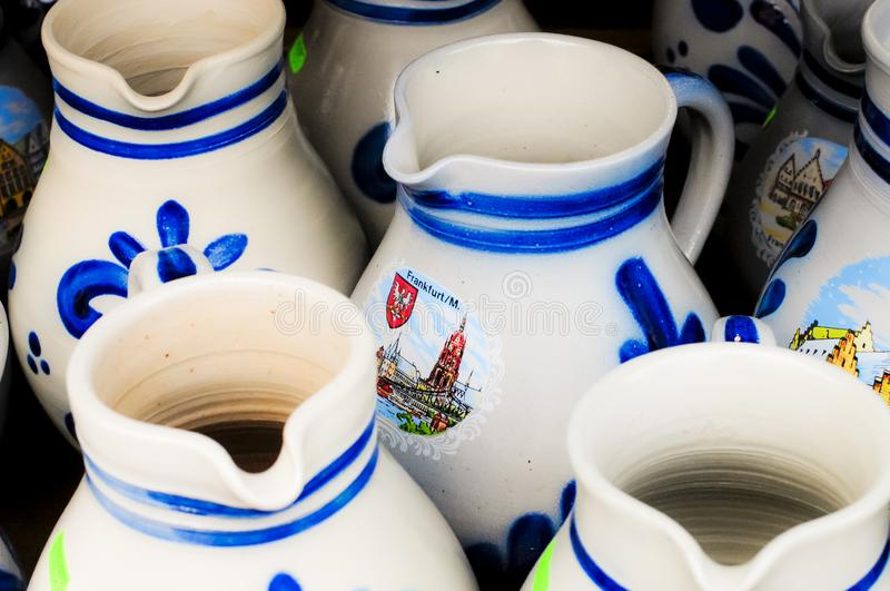 Souvenirs wine jugs. White wine jugs on sale as souvenirs at a Christmas market in Frankfurt am Main Germany royalty free stock photo