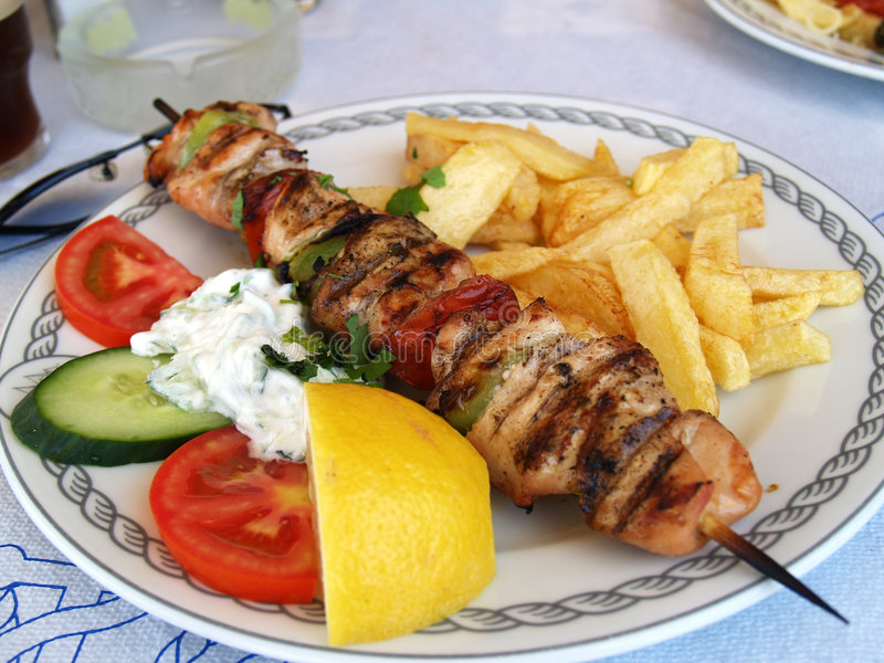 Souvlaki grec de porc de repas photographie stock