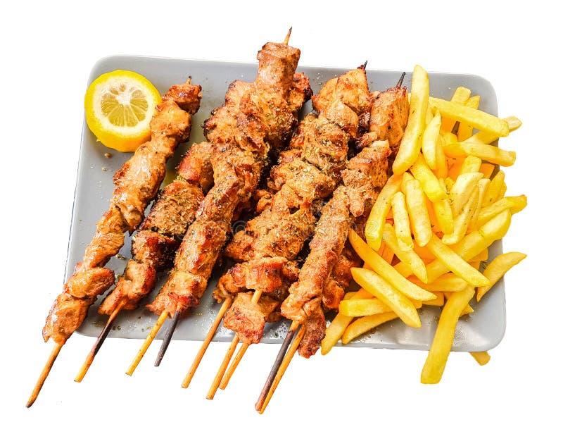 Souvlaki lokalisierte griechisches etnic Nahrungsmittelbloßes gebraten in einer Platte lizenzfreie stockfotografie