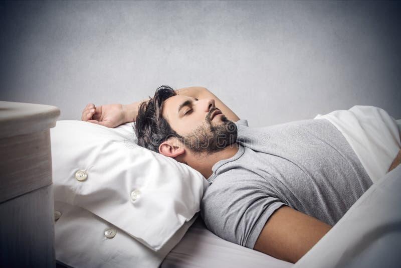 sova för man royaltyfri fotografi