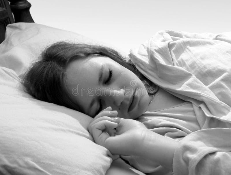 sova kvinna royaltyfri bild