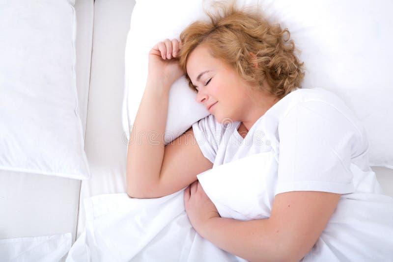sova kvinnabarn för underlag fotografering för bildbyråer