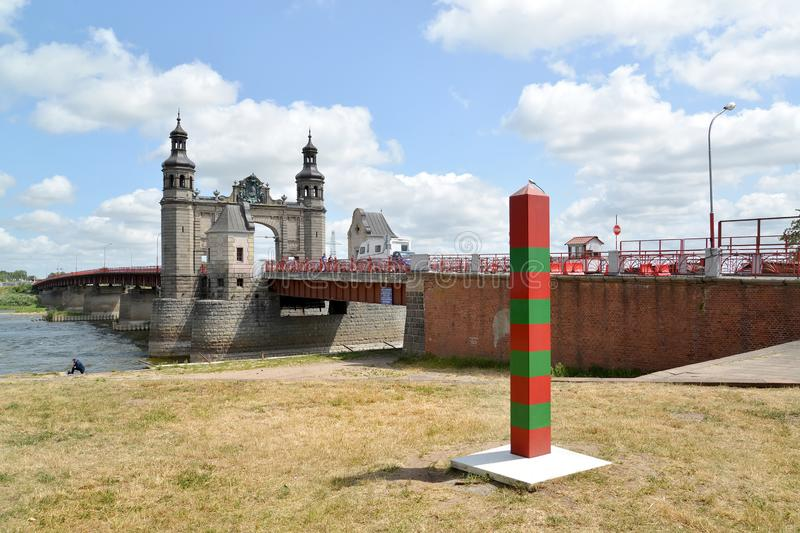 SOVETSK, RUSSIA. Boundary post against the background of the bridge of the queen Louise. Kaliningrad region.  royalty free stock photo