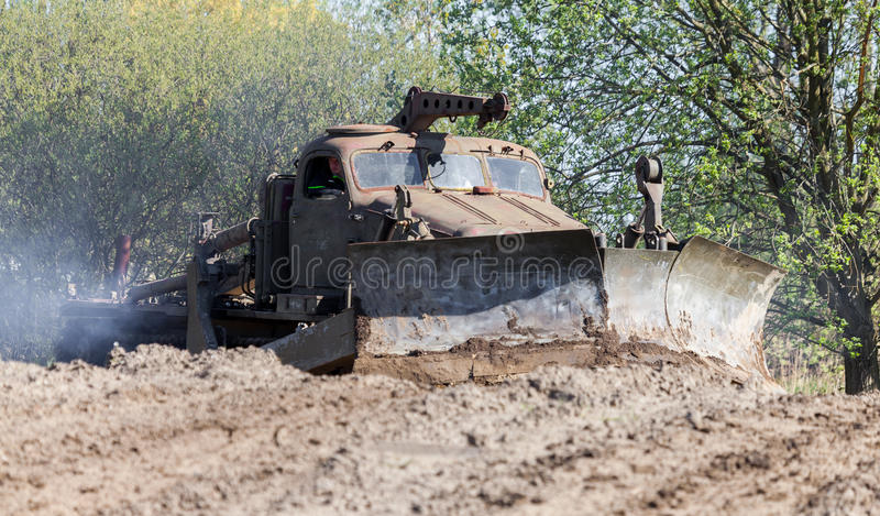 Soviet BAT - M military bulldozer drives on track on a motortechnic festival. GRIMMEN/ GERMANY - MAY 1: soviet BAT - M military bulldozer drives on track on a stock image