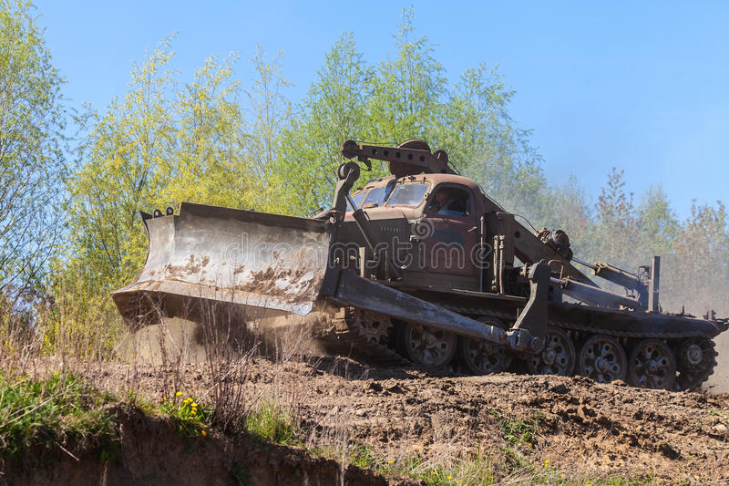 Soviet BAT - M military bulldozer drives on track on a motortechnic festival. GRIMMEN/ GERMANY - MAY 1: soviet BAT - M military bulldozer drives on track on a stock photos
