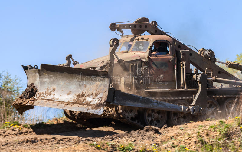 Soviet BAT - M military bulldozer drives on track on a motortechnic festival. GRIMMEN/ GERMANY - MAY 1: soviet BAT - M military bulldozer drives on track on a royalty free stock image