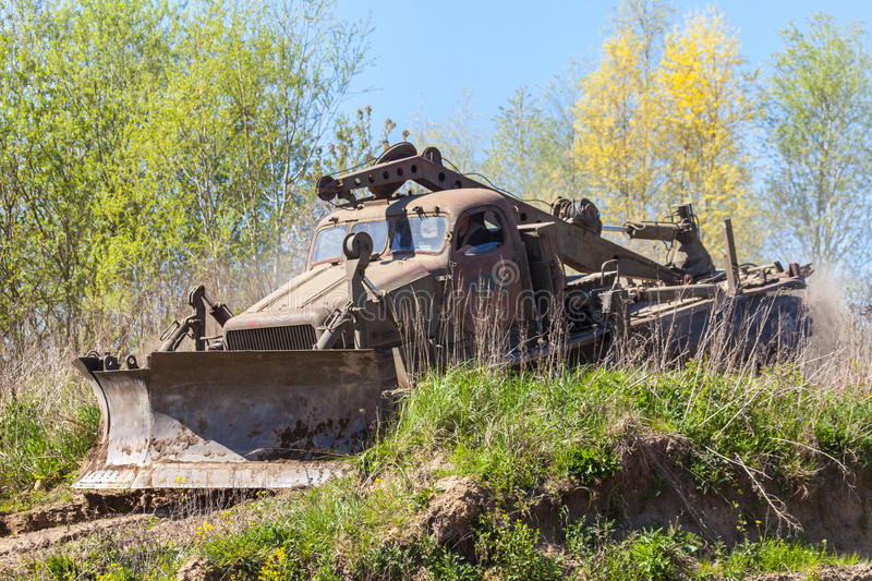 Soviet BAT - M military bulldozer drives on track on a motortechnic festival. GRIMMEN/ GERMANY - MAY 1: soviet BAT - M military bulldozer drives on track on a stock photo