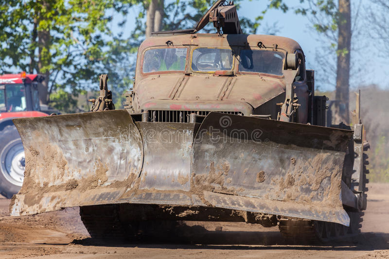 Soviet BAT - M military bulldozer stands on track on a motortechnic festival. GRIMMEN/ GERMANY - MAY 1: soviet BAT - M military bulldozer stands on track on a stock photo