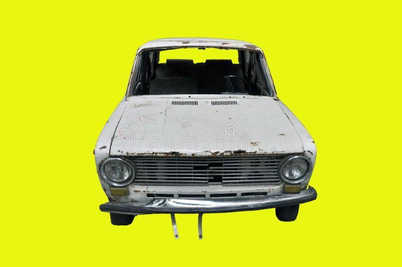 Soviet car VAZ-2101 Lada . Rusty, auto trash. Isolate on yellow background royalty free stock images