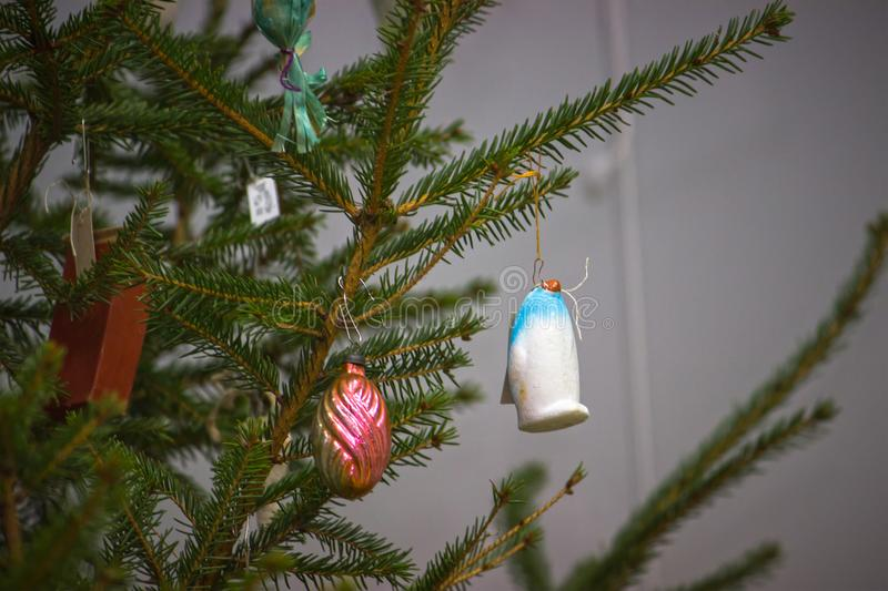 Soviet decorations hang on Christmas tree royalty free stock photo