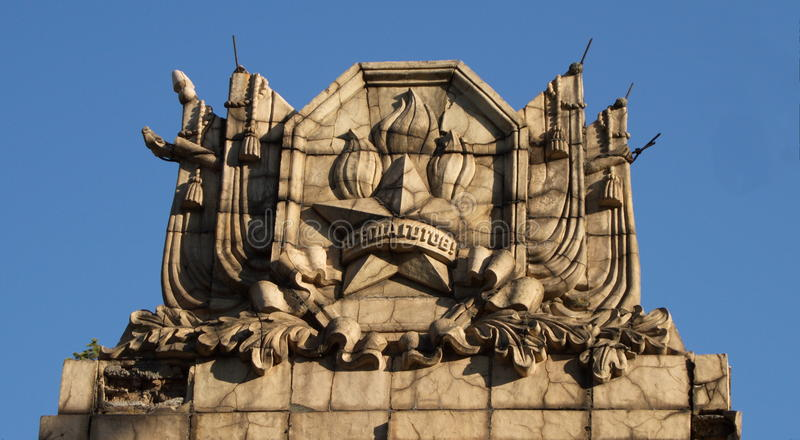 Soviet insignia on the roof of the building royalty free stock photo