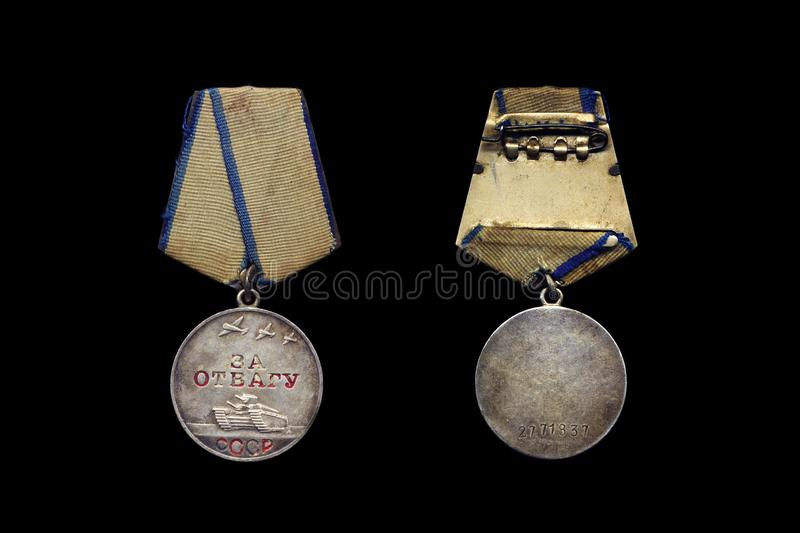 Soviet Medal `For Courage` from different sides. On a black background stock photo