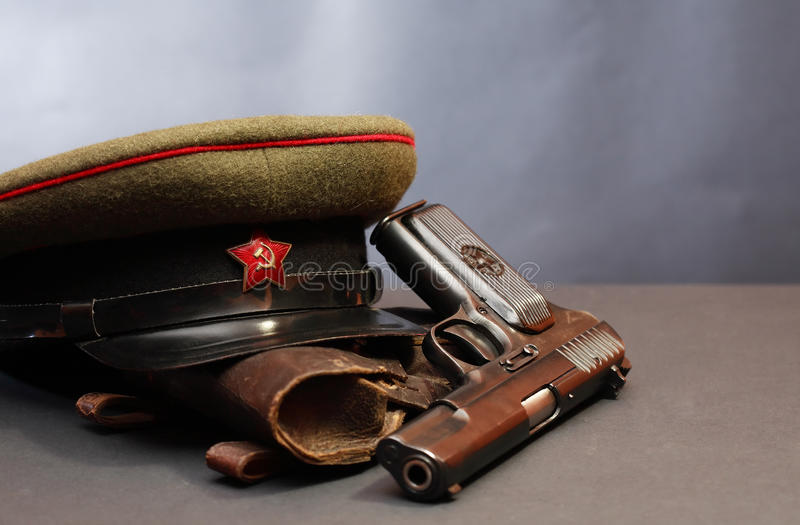 Soviet Military Officer Equipment. World War II Soviet officer equipment. Military cap near handgun and holster royalty free stock photo