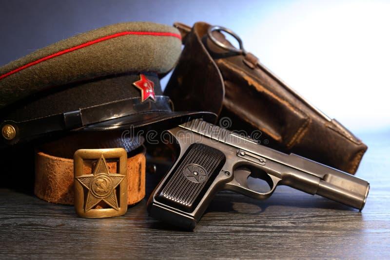 Soviet Military Officer Equipment. World War II Soviet officer equipment. Military cap near handgun and holster stock image