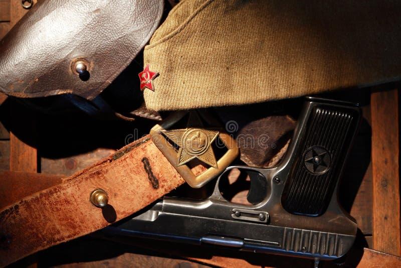 Soviet Military Officer Equipment. World War II Soviet officer equipment. Officer leather belt and garrison cap near holster royalty free stock photography