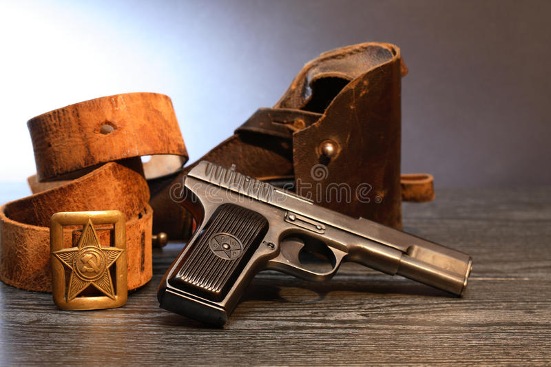 Soviet Military Officer Equipment. World War II Soviet officer equipment. Officer leather belt near handgun and holster royalty free stock image