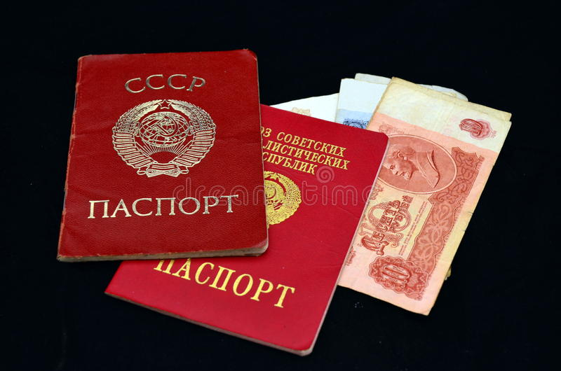 Soviet passports and money. The internal passport of the USSR (1980), the International Passport of the USSR (1990), the Soviet ruble sample in 1961 royalty free stock photography