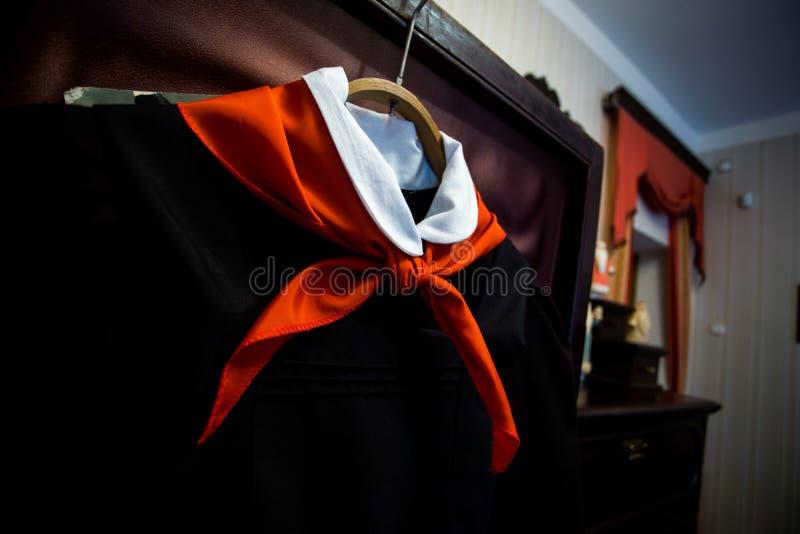 Soviet red pioneer tie on school uniform royalty free stock photo