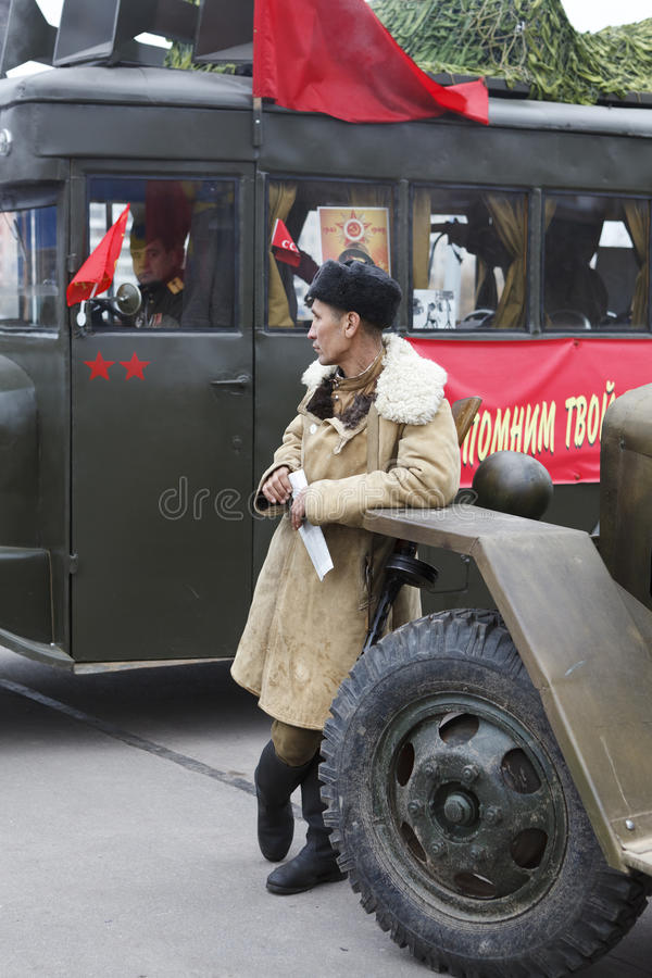 Soviet soldier standing near army lorry stock image