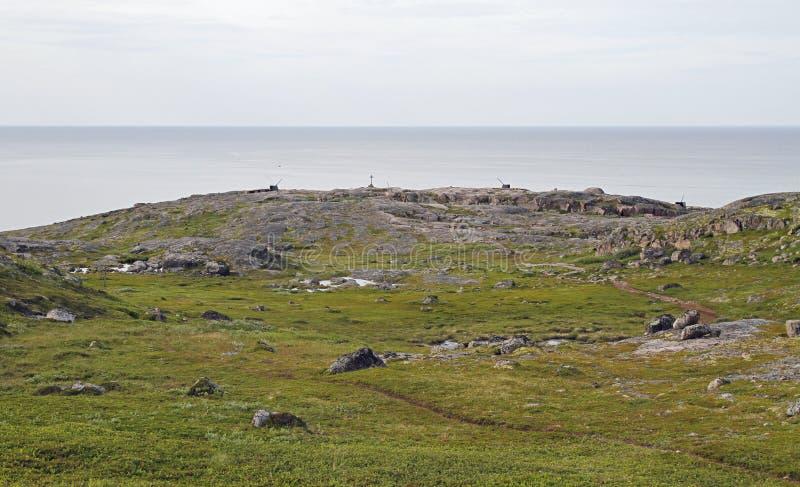 Soviet time artillery at the shore of Barents Sea nearby Teriberka royalty free stock photography