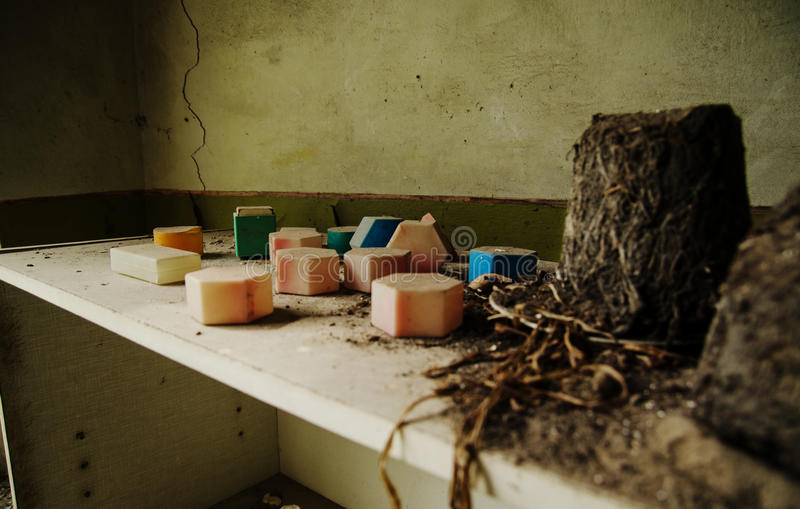 Soviet toys of dusty cubes in Chernobyl nuclear disaster area. royalty free stock photography